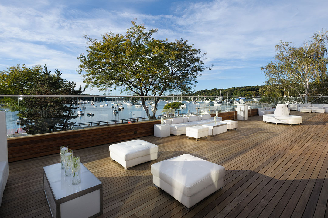 Sundeck with white furniture at Harbor Club