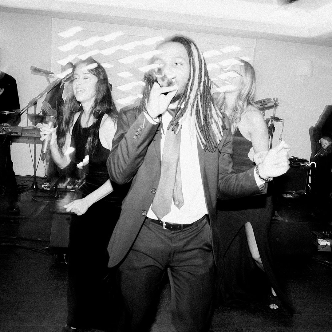 Wedding singers at harbor club in monochrome